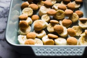 Easy 10 Minute Banana Pudding - banana slices and mini nilla wafers in dish