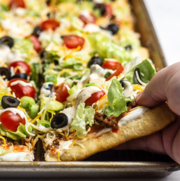 Taco Pizza combines two favorites for the perfect easy meal! This recipe is made using crescent roll dough for a tasty meal everyone will love!